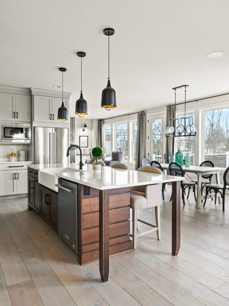 a dark walnut stained shiplap island is the centerpiece of this modern farmhouse kitchen